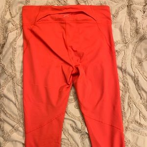 Under Armour orangey-red cropped leggings